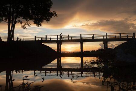 Selective focus silhouette bridge sunset evening time