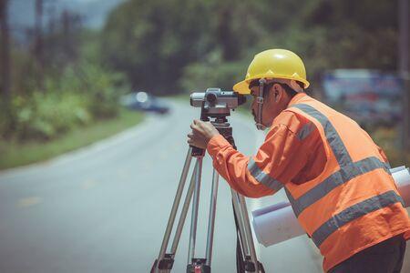 Surveyor engineers work on road construction.