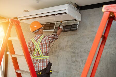 air conditioner repair technician service at home 写真素材