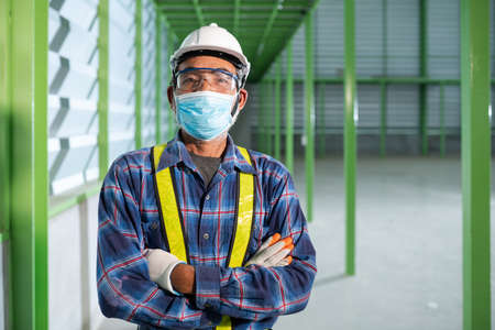 Senior engineer wearing a mask to work new normal