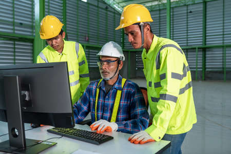 Engineering team working use computer operate in the warehouse design 写真素材