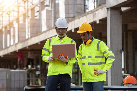 Supervisors and engineering use laptop at the construction site