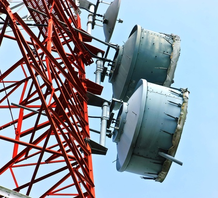 low angle view of  telecommunications towers against the sky photo