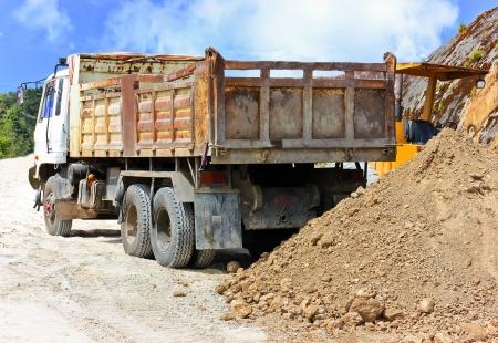 panning shot: Coal dump truck working hard at site. Motion blurred panning shot Stock Photo