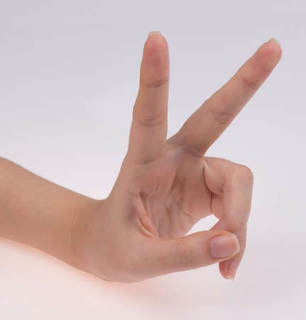 choosing selecting: hand sign Stock Photo