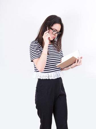 jot: background, beautiful, casual, clipboard, clothes, document, down, female, folder, german, girl, hair, happy, isolated, jot, lady, one, paper, pen, people, person, portrait, pretty, record, shirt, smile, student, studio, teen, teenager, top, university, w