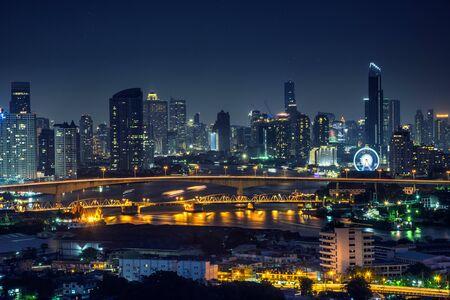 Bangkok thailand cityscape at night many tower near river Stock Photo