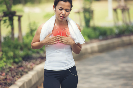 Jogging woman with chest pain after jogging work out