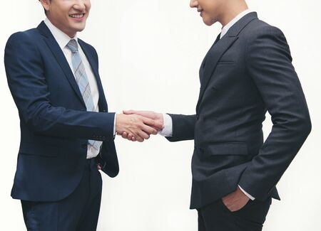 Businessmen making handshake on white - business etiquette, congratulation, merger and acquisition concepts