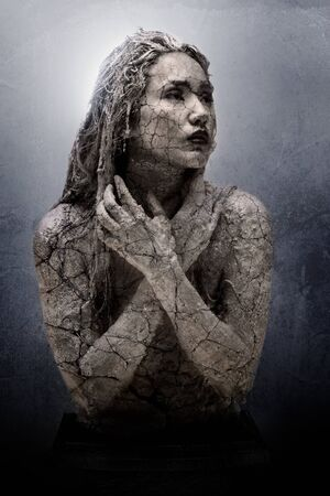 Cracked face of female traditional sculpture fashion portrait
