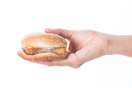 woman Hands holding a hamburger  isolated on white background