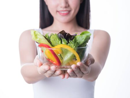 Healthy asia woman with salad Isolated on white background. Healthy lifestyle vegetarian green food.