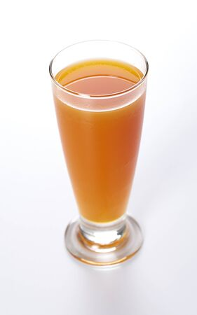 glass of fresh carrot juice isolated on white background