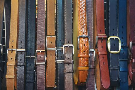 sale of belts for jeans and trousers, texture, different colors. Varieties of belts for sale