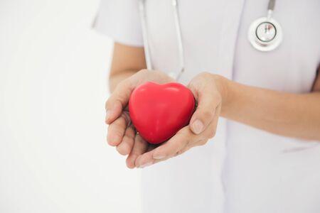 Nurses use hands to show heart shape concept