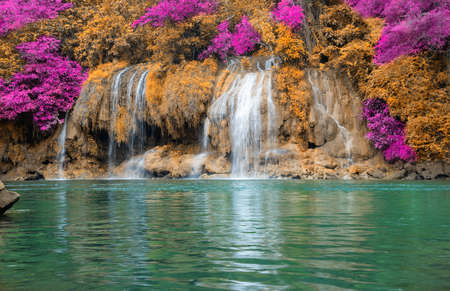 Beautyful waterfall nature season spring in forest thailand. Amazing waterfall at colorful autumn forest in fall season