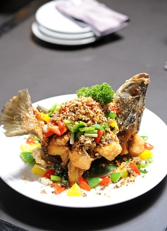 thaifood fish fried with herb Stock Photo