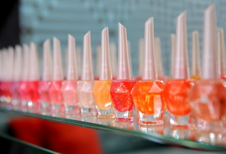 Bottles of nail polish in different shades photo