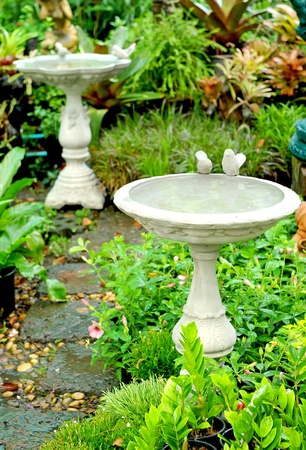Small decorative fountain in a city park Stock Photo