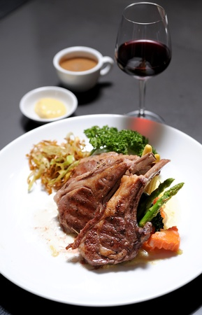 steak dinner: Roasted lamb chops with wine Stock Photo
