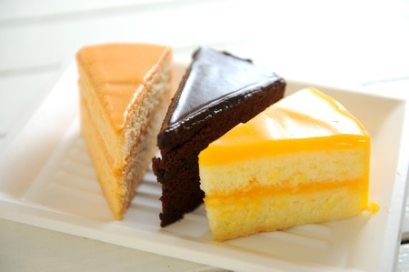 soft cake chocolate and tea and orange photo