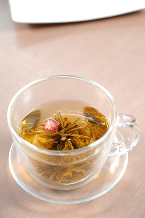 chamomile tea: cup of tea and chamomiles