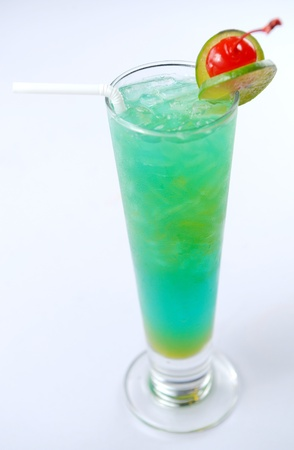 Closeup of a blue cocktail drink with lemon slices photo