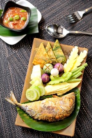 Fried Mackerel fish,chili sauce ,and fried vegetable photo