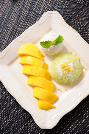 Thai style tropical dessert, glutinous rice eat with mangoes photo