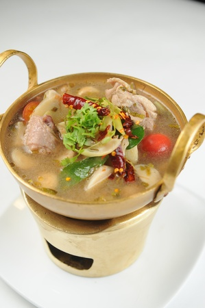 thai noodle soup: chicken wing tom yum in bowl