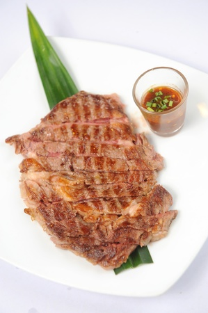 Grilled beef steaks isolated over white background set photo