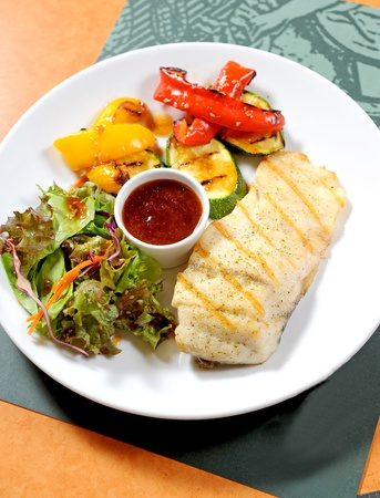 Fish steak with vegetables photo