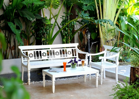 garden furniture: A telephoto of White Garden table and chairs