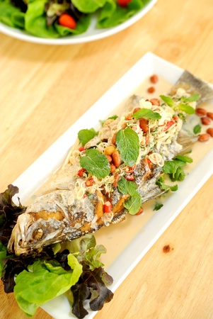 Thai food fried fish with spicy sauce photo