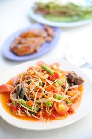 Thai papaya salad is made from papaya photo