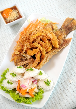 Fried fish with sauce photo