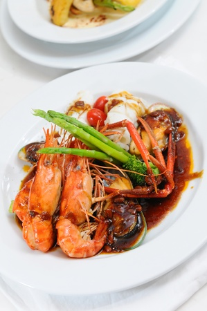 Seafood on white plate photo