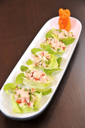 appetizers menu: Closeup of fresh vegetable salad with tuna