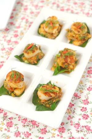 Scallops on a plate decorated photo