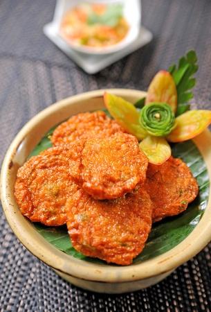 Thai Food - fried fish mix herbs photo