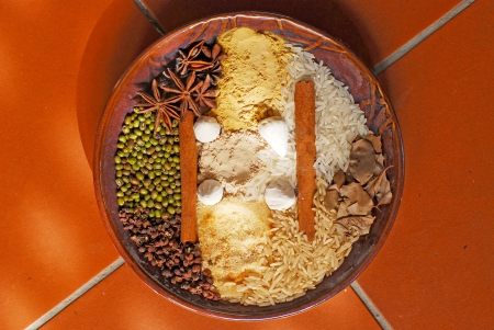 Spices in wooden plate photo