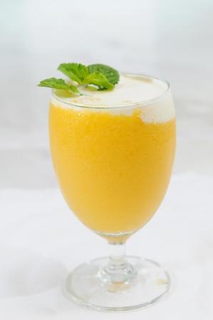 mango isolated: Glass of mango juice Stock Photo