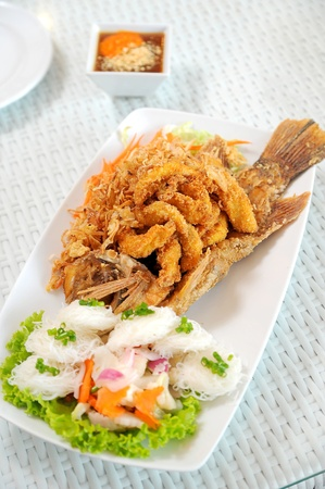 Fried fish on the white plate photo