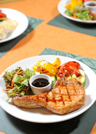 t bone steak: grilled steak and vegetables Stock Photo