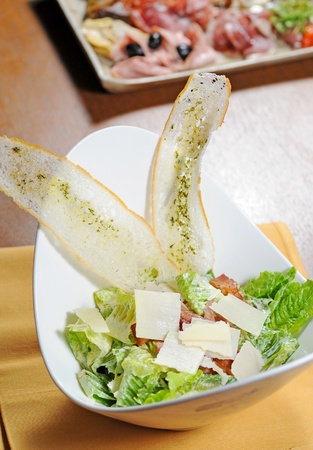 Ceasar salad with lots of dressing photo
