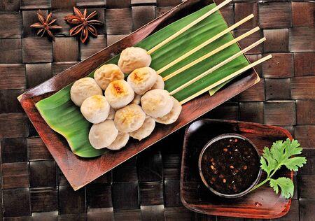 Grilled pork meatball on bana leaves Stock Photo - 11532046