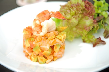 starter: king prawns with salad on a plate Stock Photo