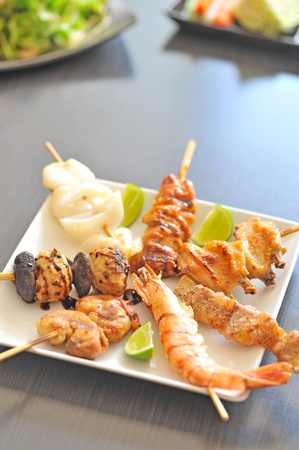 Variety of seafood grill on plate photo