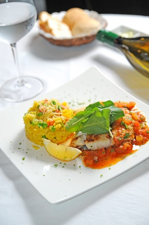 tilapiini: fish steak and rice