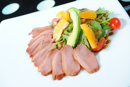 Duck and salad on a plate Stock Photo